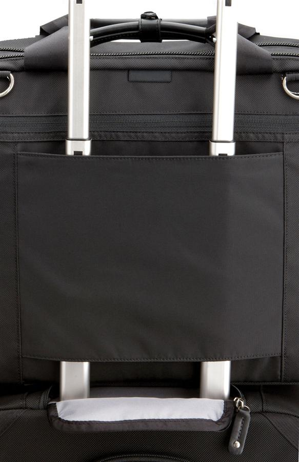 Two Built-In Pass Throughs for Piggy Backing on Another Rolling Bag Via its Handle